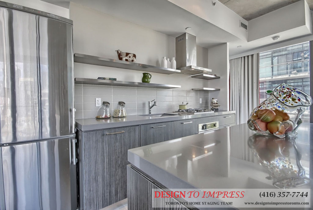 Kitchen Counter, Island, and Fridge, 560 King St. West, Toronto Condo Staging